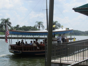 One of the charming resort launches that shuttle guests across the Seven Seas Lagoon and Bay Lake.